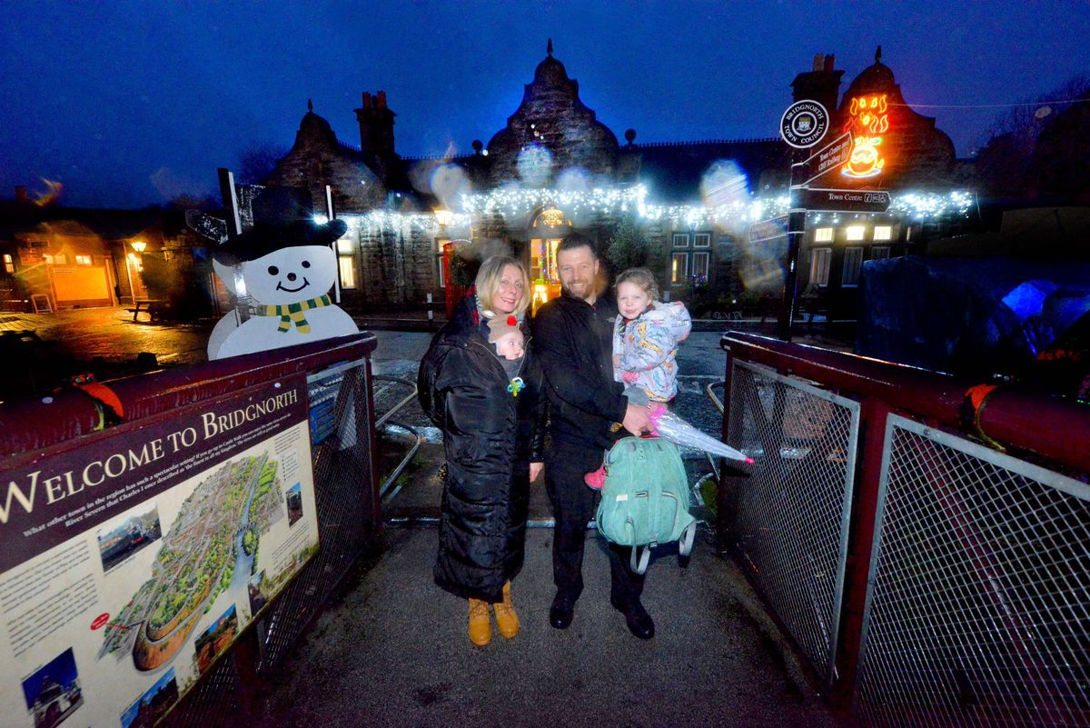 LAST COPYRIGHT SHROPSHIRE STAR STEVE LEATH 10/12/2019..Pic in Bridgnorth at the Severn Valley Railway where they had there Lights and Steam event ( pics taken in torrential rain).  Alex Webb and TJ Webb 5 months and Craig  and Brooke 3 Webb , Stourport..