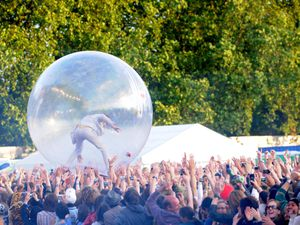 Wayne Coyne of The Flaming Lips performs inside of a giant plastic ball at Lovebox festival, east London in 2008