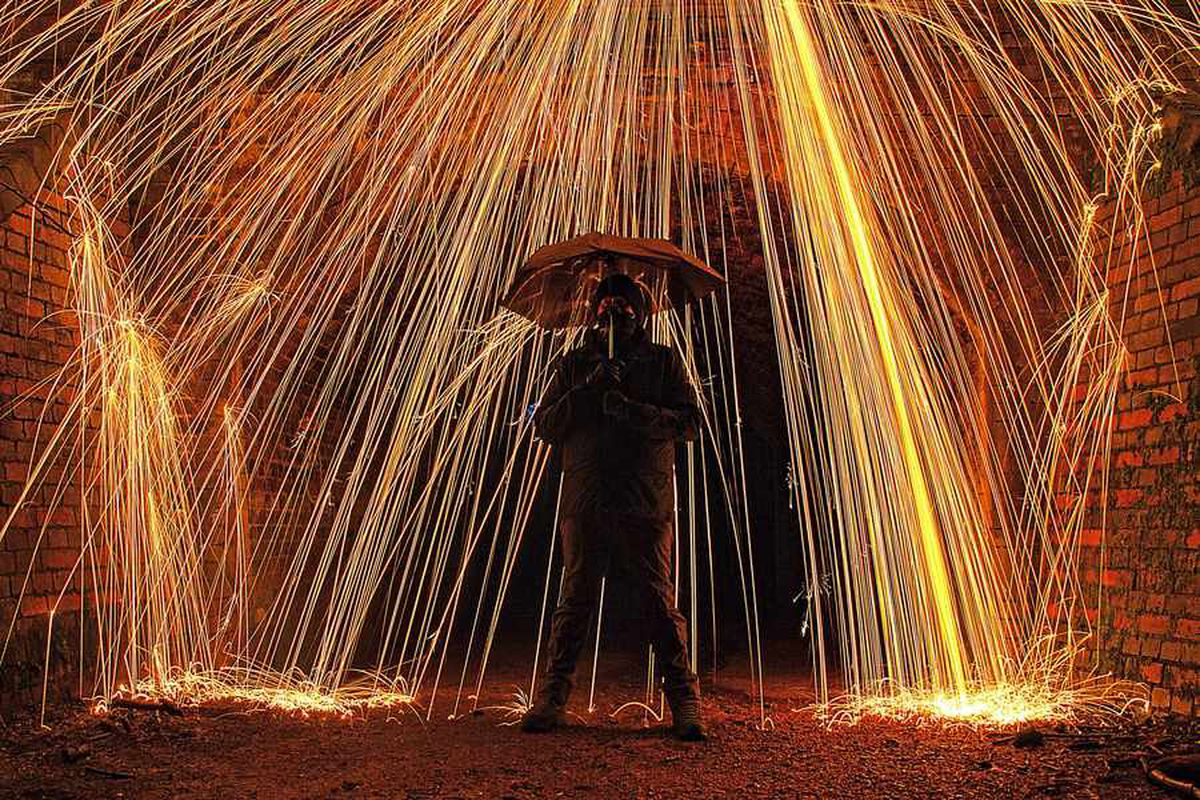This image was taken by Stephanie Clarke and shows husband James standing under a shower of sparks