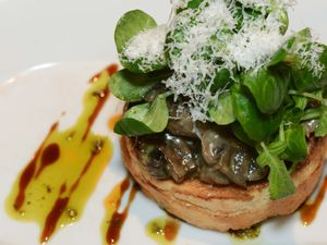 The creamy garlic mushrooms with toasted brioche and parmesan shavings served at The Cowshed was displayed pleasantly on the plate, food critic Leigh Sanders said