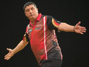 Ruthless: Mensur Suljovic at the Grand Slam      Picture: Lawrence Lustig/PDC