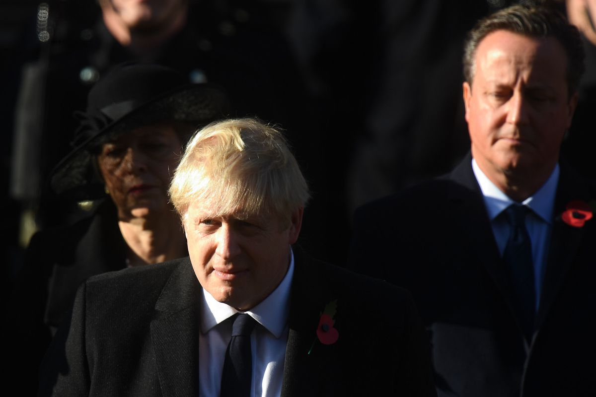 Prime Minister Boris Johnson and former prime ministers Theresa May and David Cameron during the Remembrance Sunday service at the Cenotaph memorial yesterday