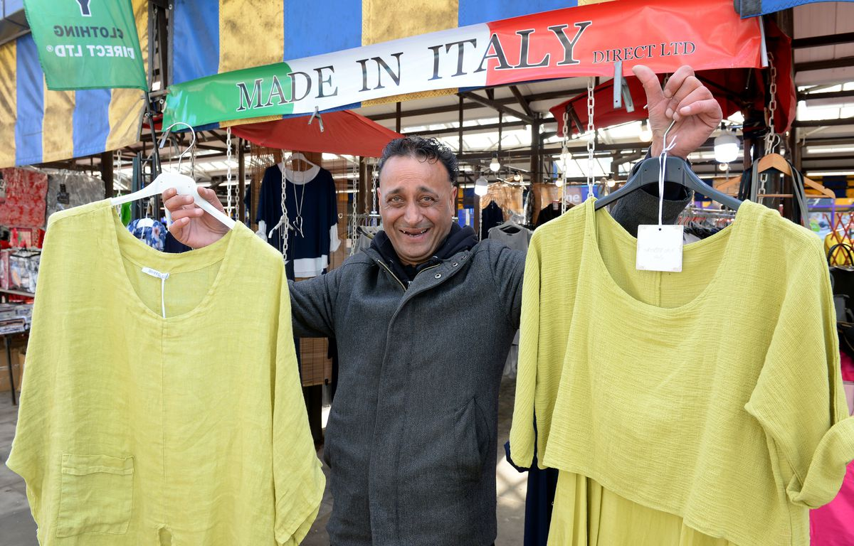 Dudley Market trader Pete Singh, celebrates now being able to sell clothes again