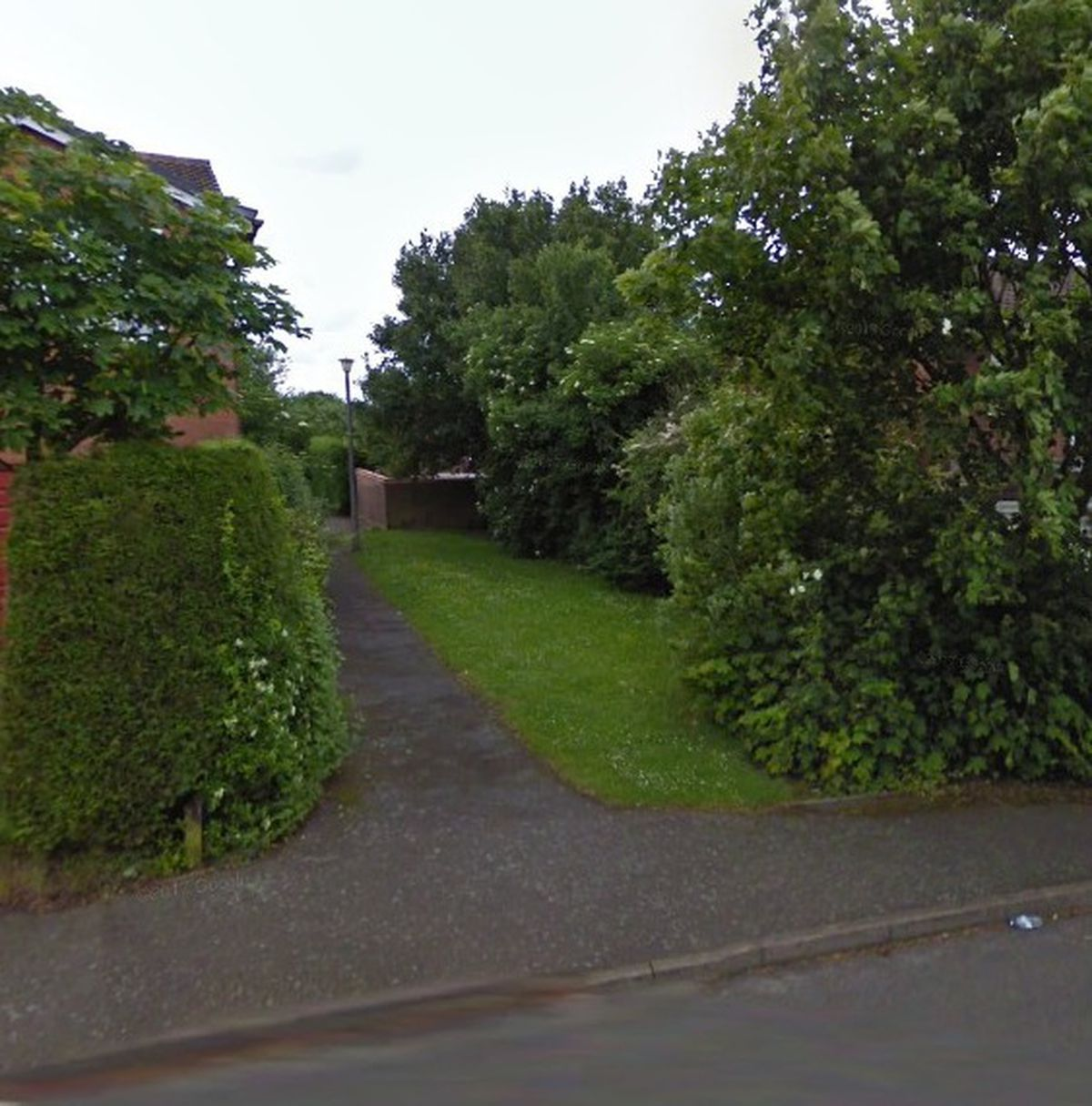 A Google Street View image from 2009 of the green space on Meadow Way Hawks Green that has become part of a private garden. The public footpath remains open