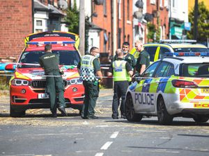 Emergency services at the scene of the crash in Stourbridge Road, Halesowen. Photo: SNAPPER SK