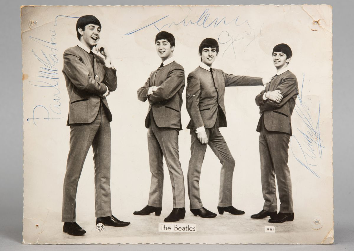 The photo signed by all four members of The Beatles