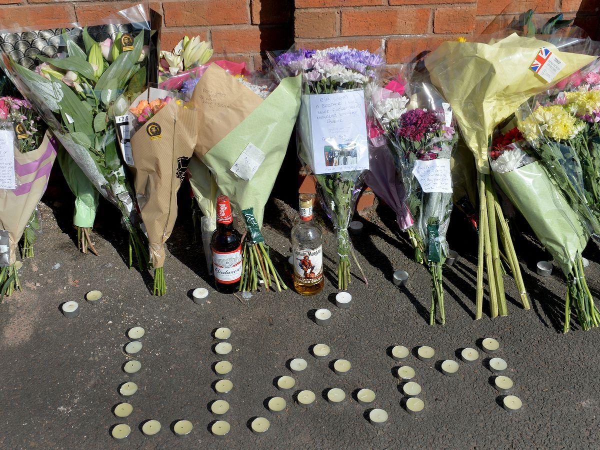 Tributes to Liam Ryan left at the scene in Essington Road