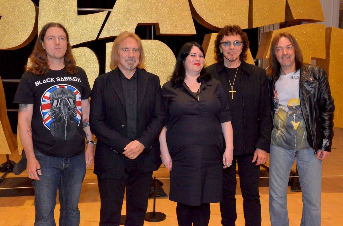 Chris Hopkins, Curator Lisa Meyer and Steve Knowles with Tony Iommi and Geezer Butler