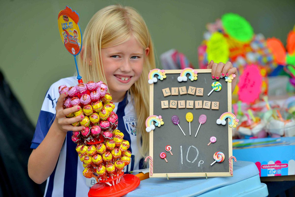 Lily Perkins, eight, with her lolly stall at Silverdale Football Club
