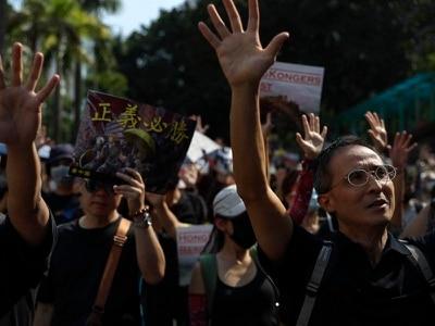Hong Kong protesters defy police ban to press 'five main demands'