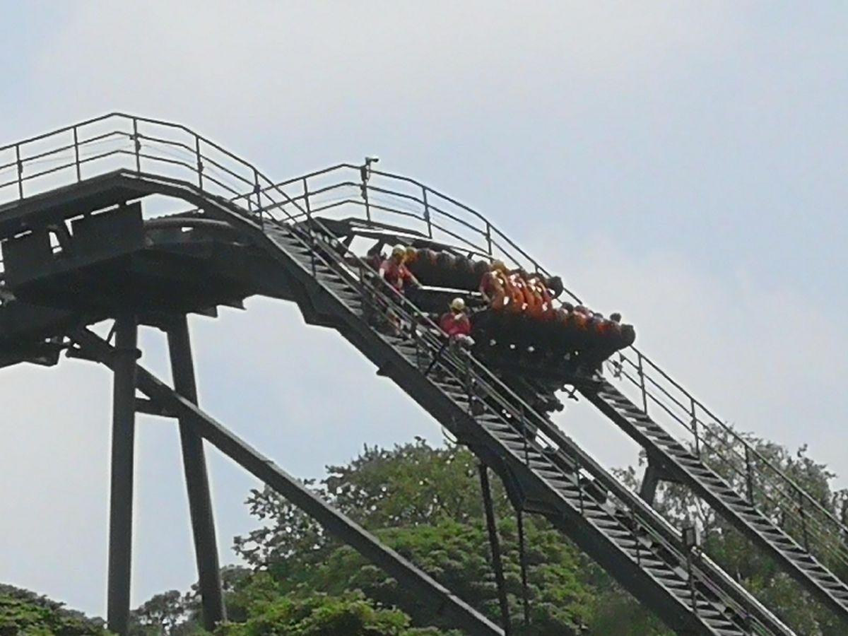 Officials helping passengers stuck on Oblivion after it broke down. Picture: Grant Jones