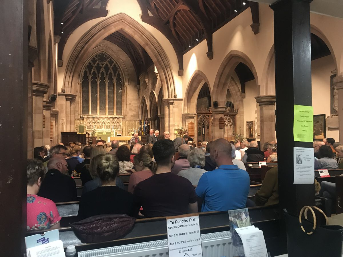 Residents in the packed church