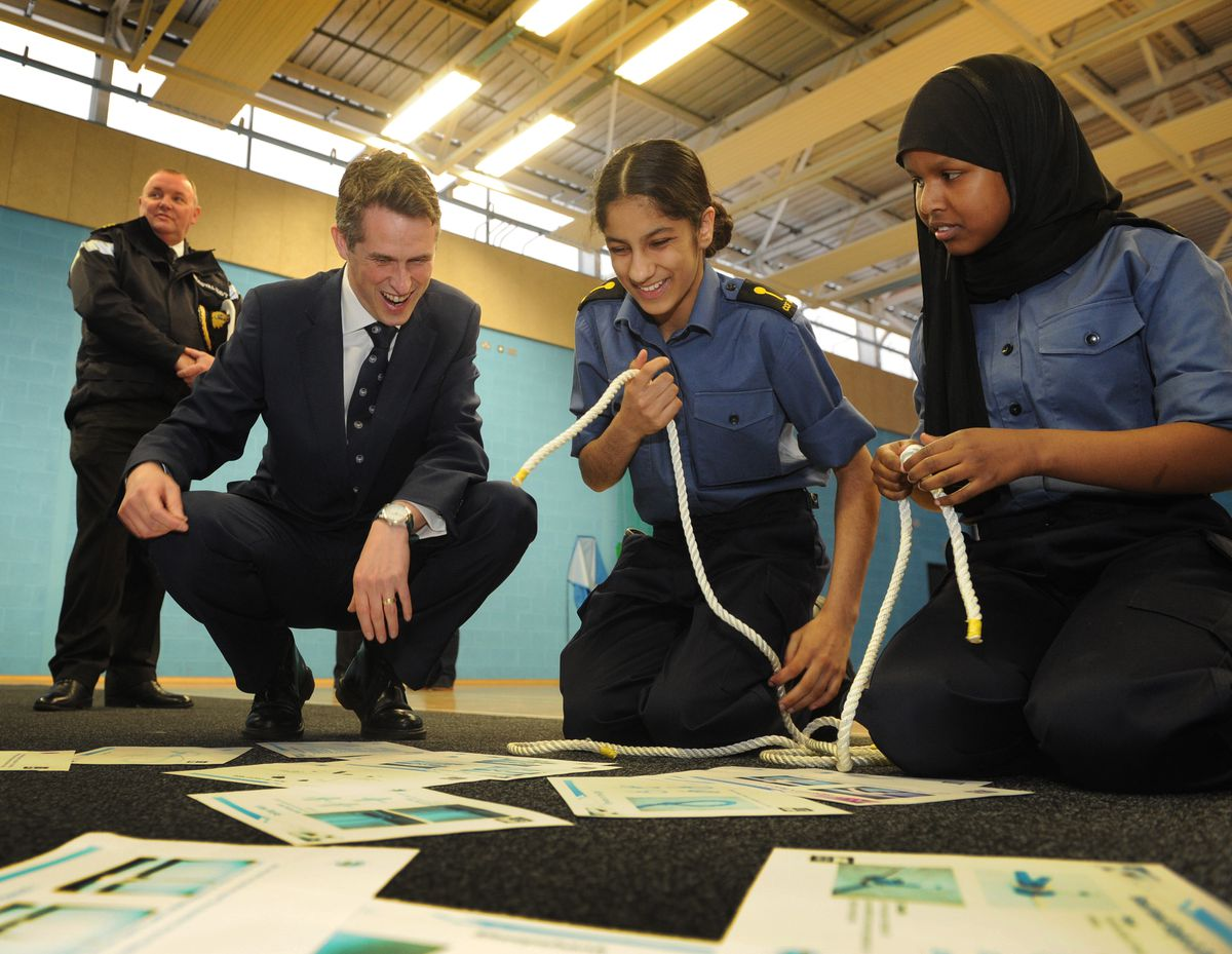 The Defence Secretary with two of the cadets