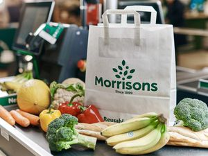 A Morrisons paper bag and fresh produce