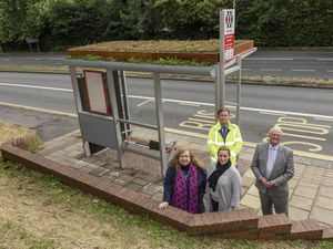 Councillor Kath Hartley, Eve O'Connor, Councillor Ian Kettle and behind Mark Purnell at the new shelter