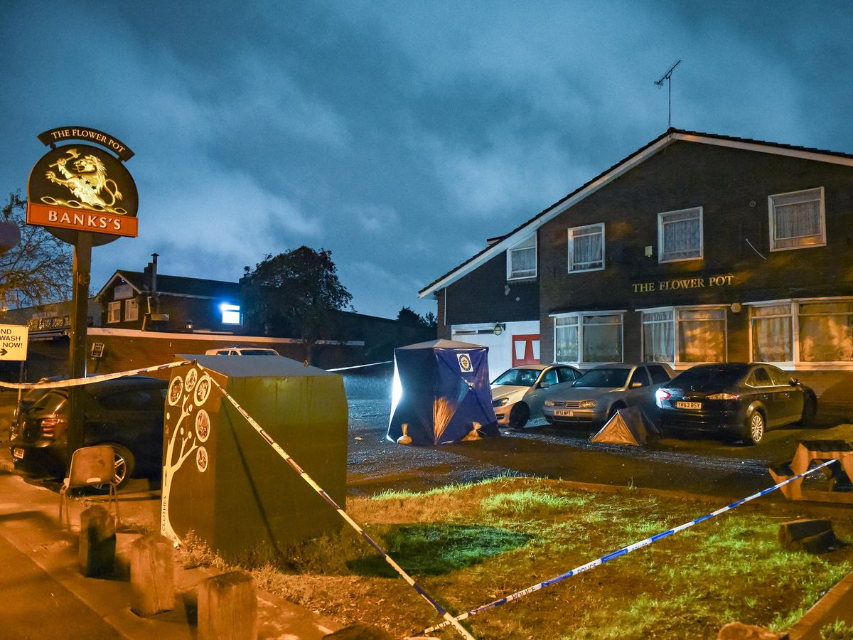A police tent and cordon outside the Flower Pot pub, in Spon Lane, West Bromwich. Picture: @SnapperSK