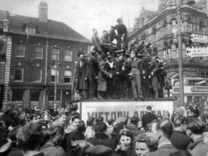 Some in the crowd in Queen Square, Wolverhampton, on the afternoon of VE Day, clambered onto the Prince Consort's statue.