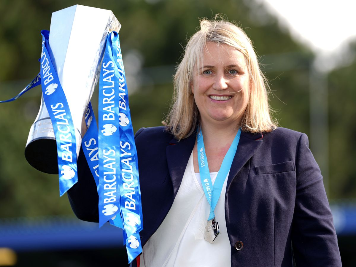 Chelsea manager Emma Hayes celebrates with the Women's Super League trophy