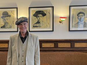 Owner Tony Mckeon sports his Peaky Blinders cap inside The Office