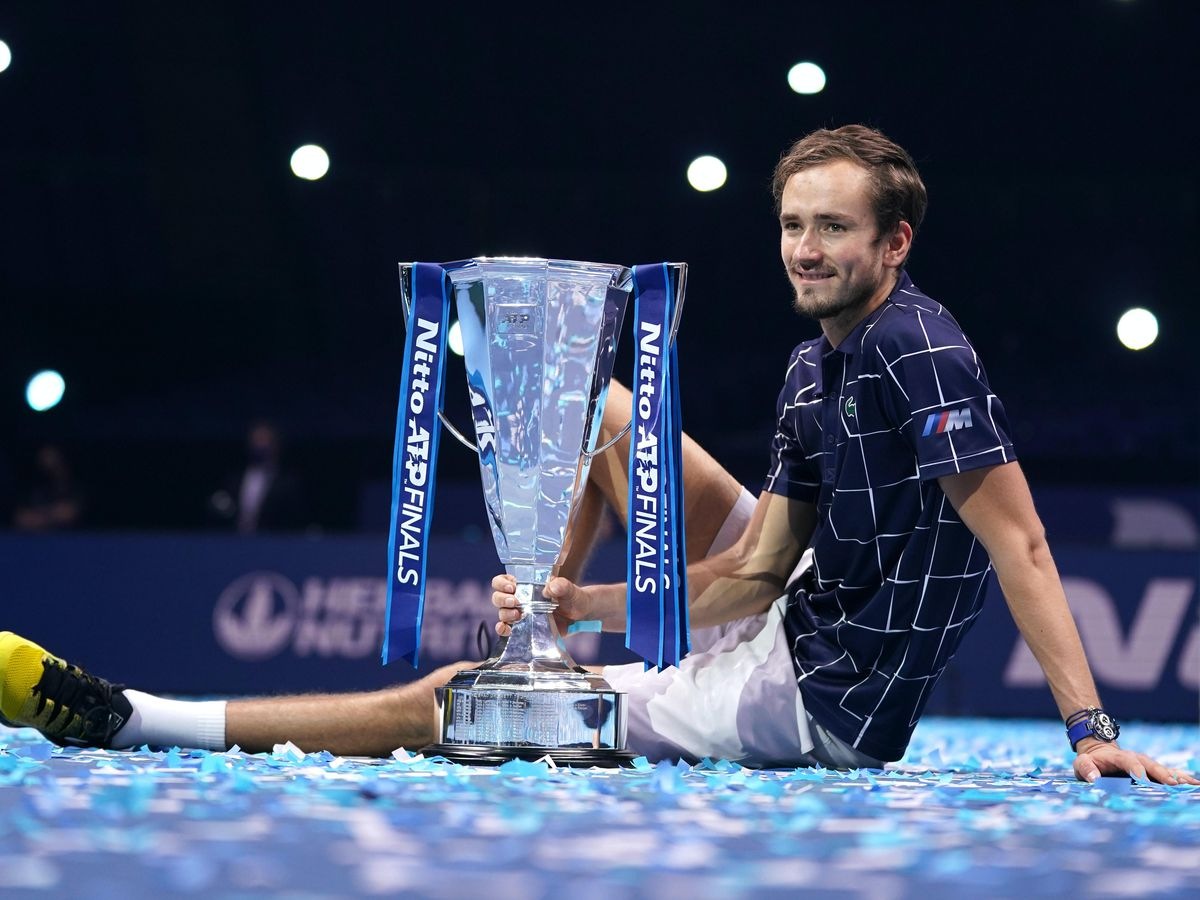Daniil Medvedev poses with the Nitto ATP Finals trophy
