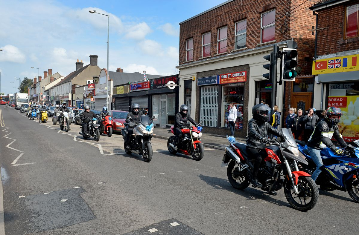 Motorcyclists rode alongside the procession