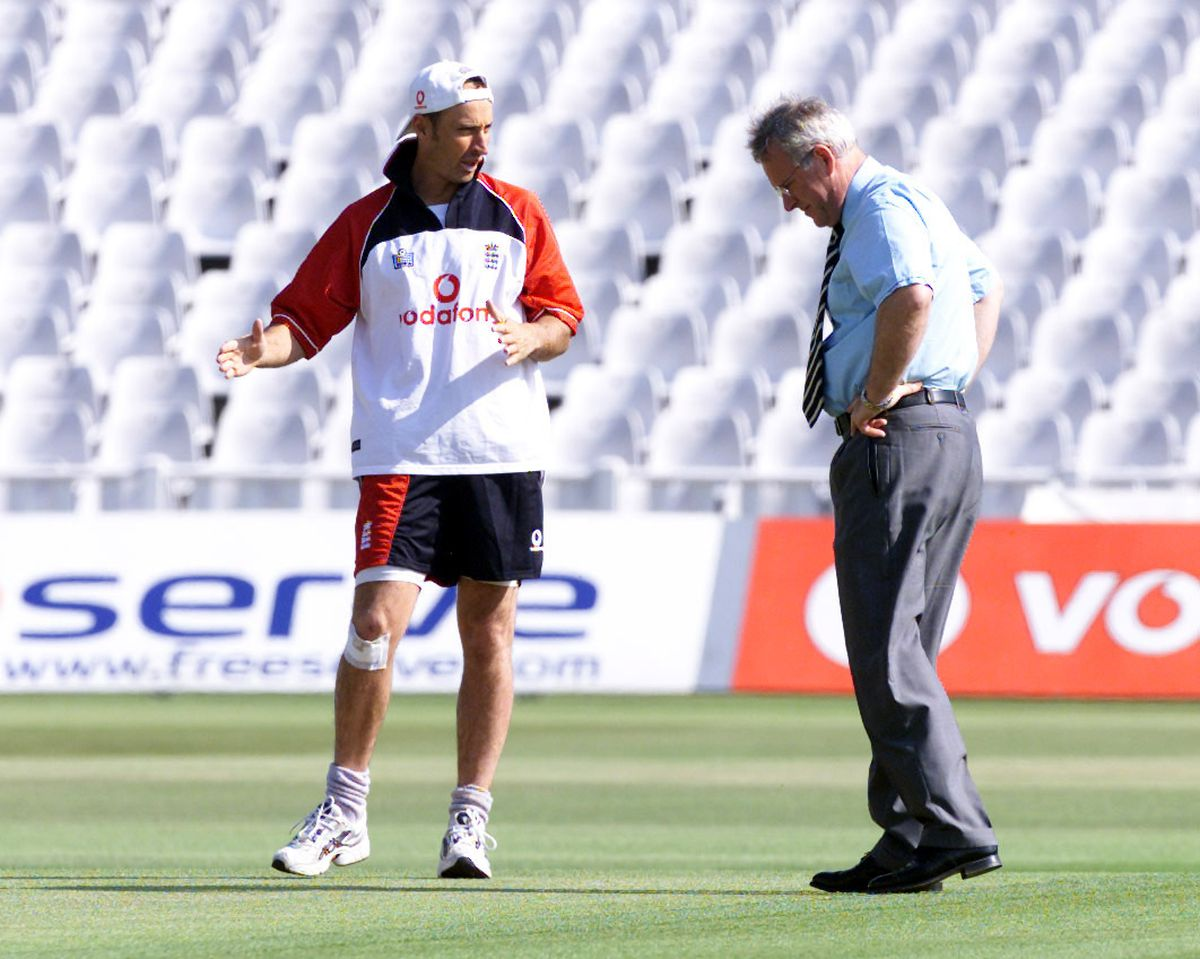 Nasser Hussain inspect the wicket with Dennis Amiss (right)