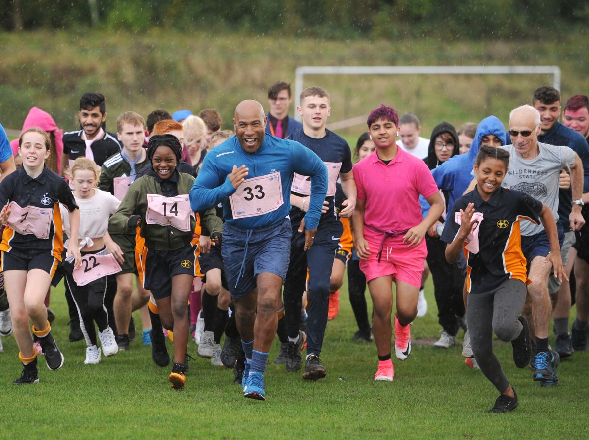 Staff and students take part in a 5k run to raise money for Cancer Research