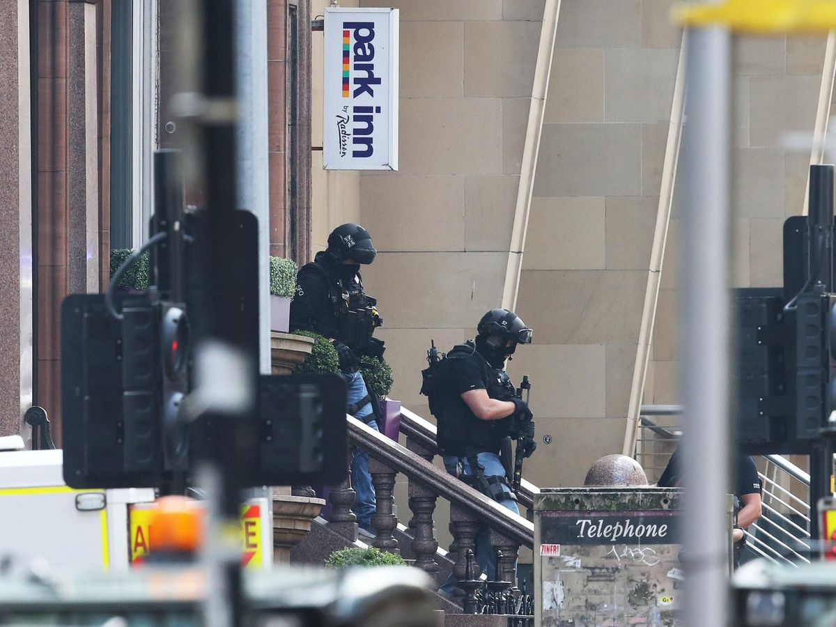 Armed police officers leave the Park Inn hotel in West George Street