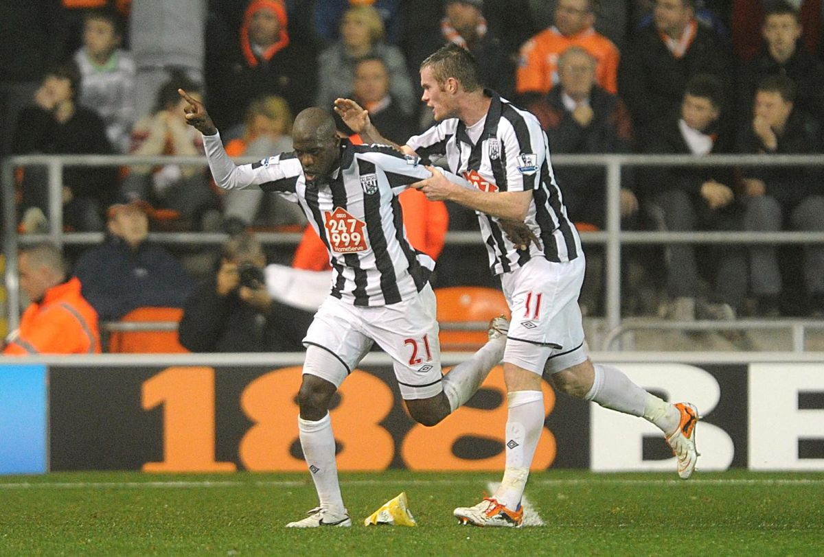 West Bromwich Albion's Youssouf Mulumbu (left) celebrates with team-mate Chris Brunt