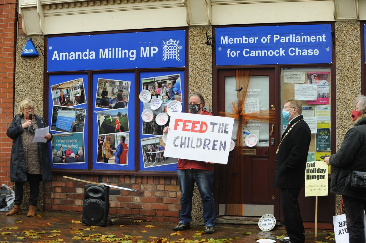 Protestors gather outside the office of Amanada Milling MP's office in Hednesford