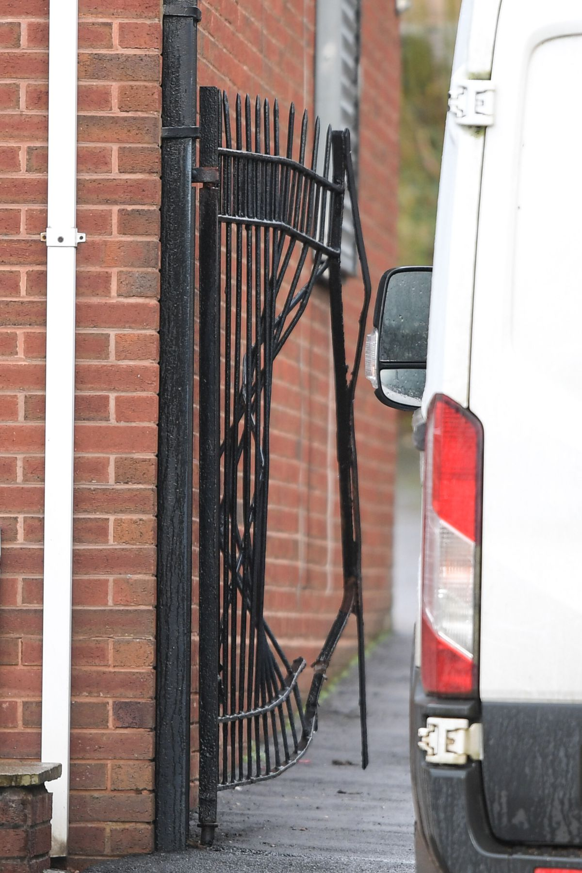 The raiders rammed the side gates to break in to the property (Image by SnapperSK)