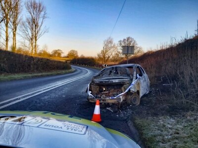Appeal after burnt out car abandoned on roadside