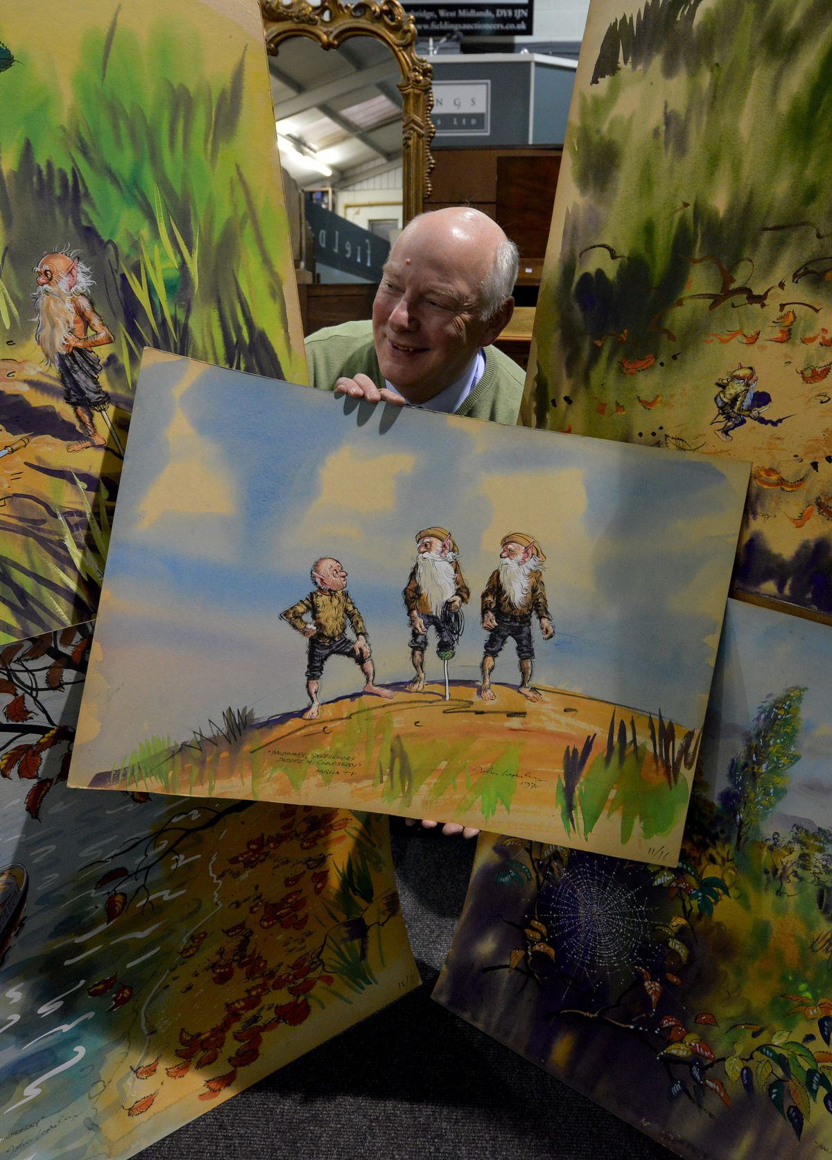 Illustrations by artist John Worsley from the 1970's TV series 'The Little Grey Men' will be going under the hammer at Fieldings in Stourbridge and are expected to fetch between £50- £100 each. Pictured is picture consultant Bill Lacey.
