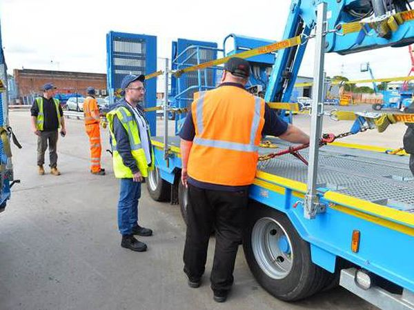 Cleveland McGrory being shown how to load a lorry at the apprentice day