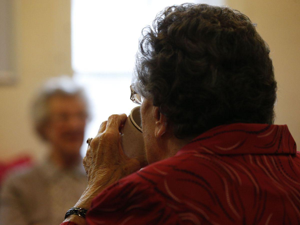 Elderly people at tea party