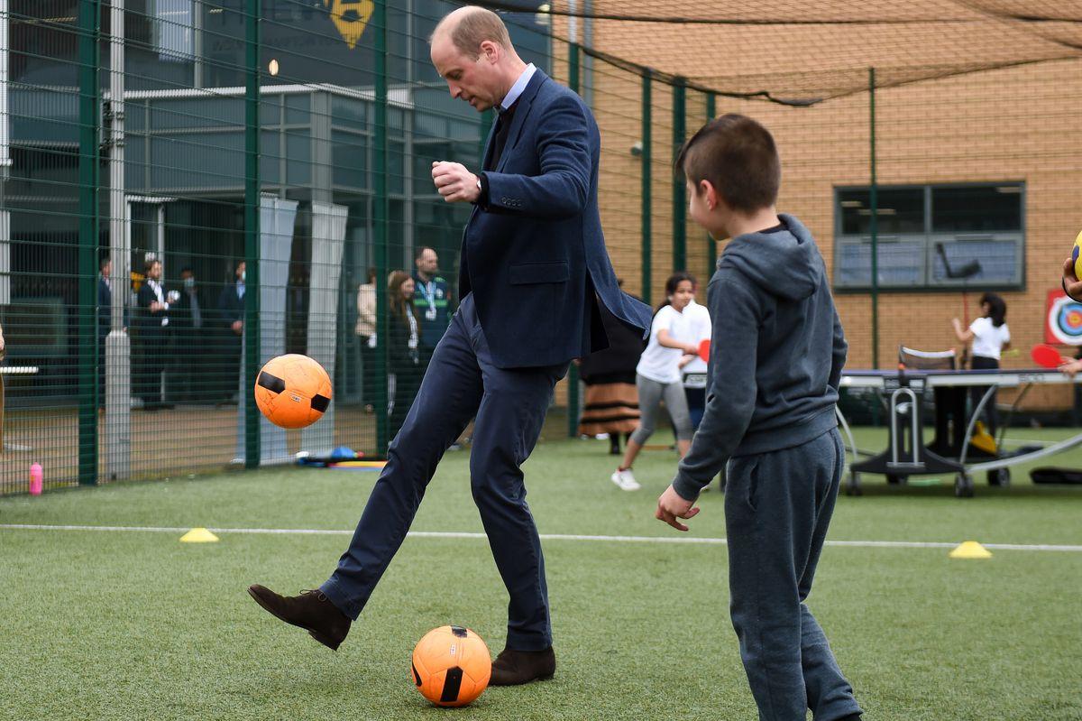 The Duke of Cambridge kicks a football Photo: Jacob King/PA Wire