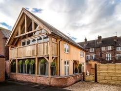 Former garage plot transformed into award-winning bijou village home