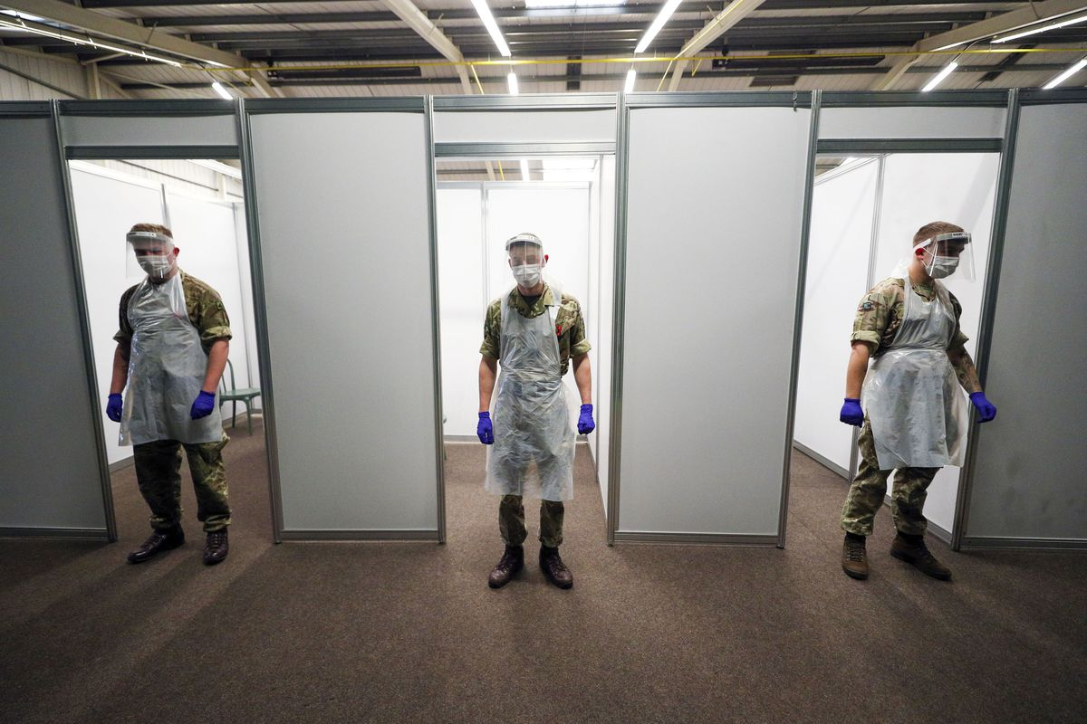 Soldiers practice on themselves at the Liverpool Tennis Centre in Wavertree, before the start of the mass Covid-19 testing in Liverpool.