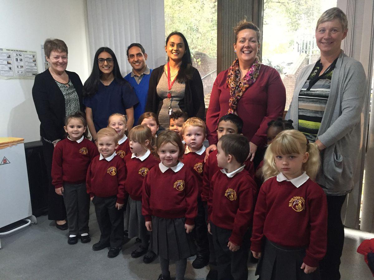 Staff at the Church Street practice in Bilston with children