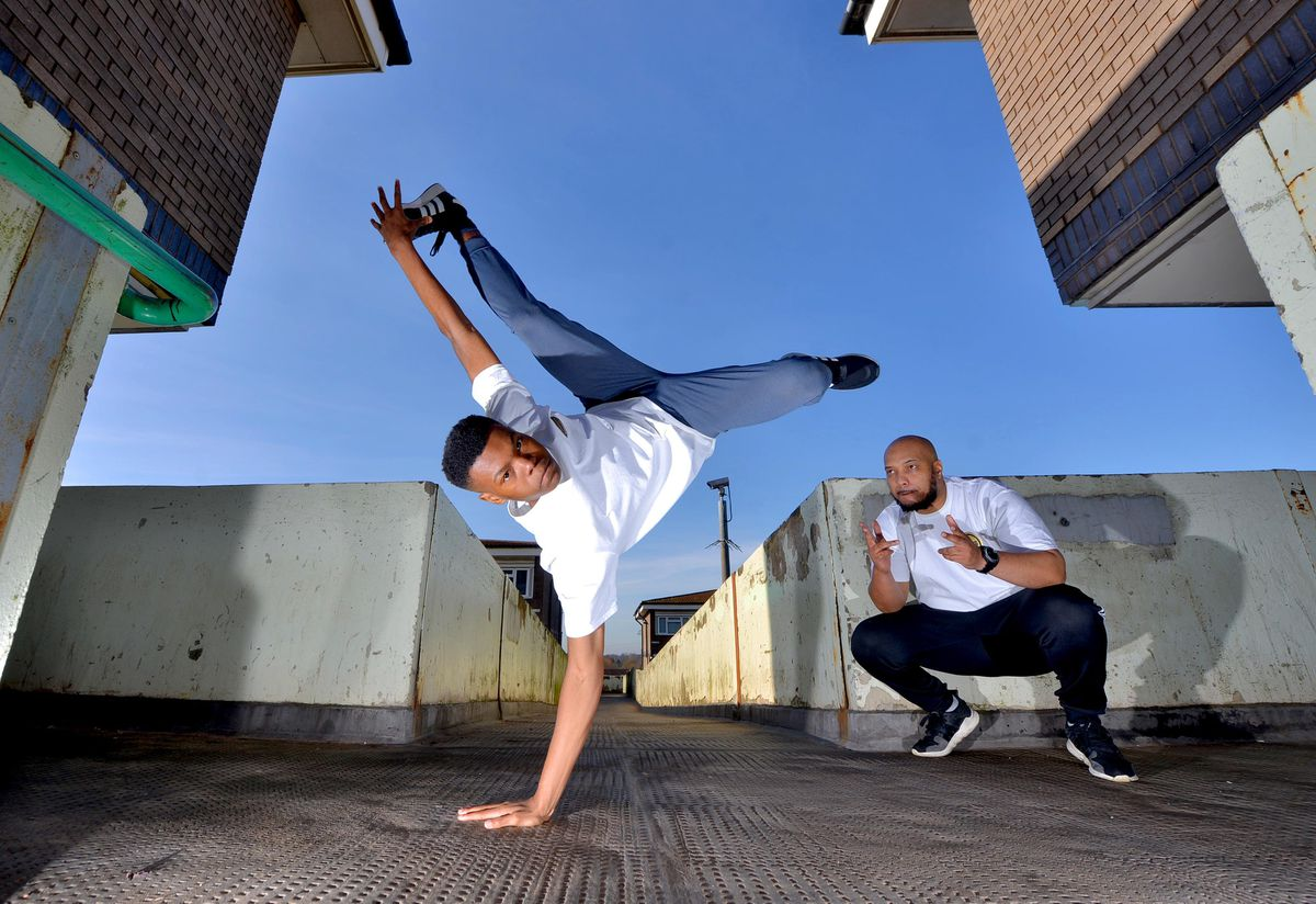 Aijion Brown, better known in the breakdance world as A J The Cypher Cat, watched by his father Pablo