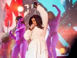 Cardi B performs in bathrobe after wardrobe malfunction