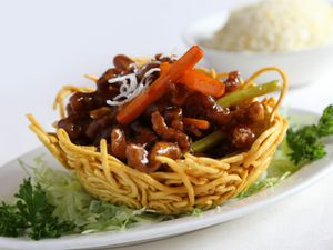 Honey chilli crispy beef on a noodle bird's nest