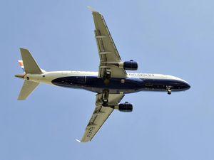 Air plane flies as seen from below
