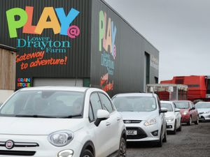 Cars travel through Lower Drayton Farm to order at the new drive-through burger bar