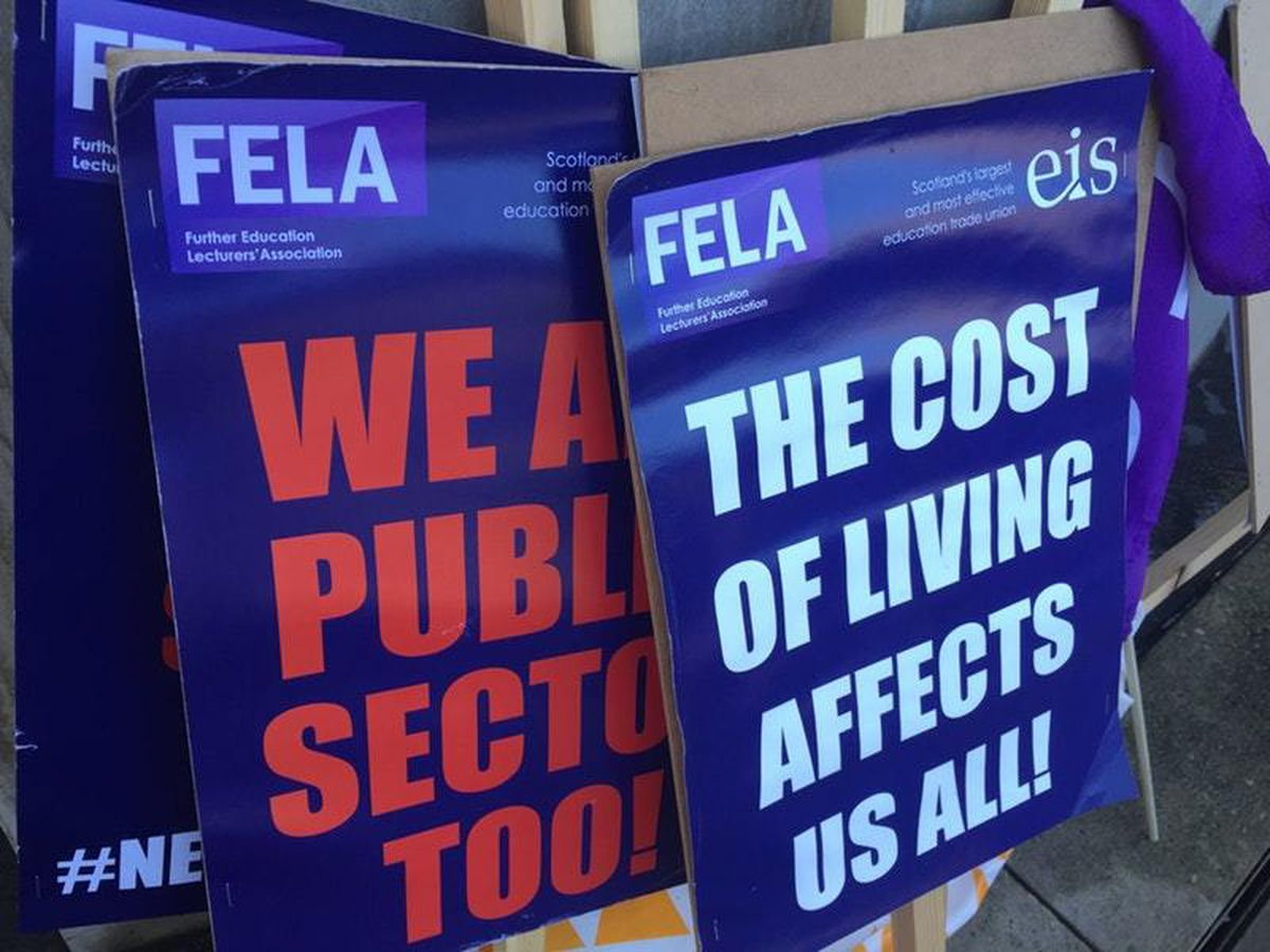 College lecturers' strike signs