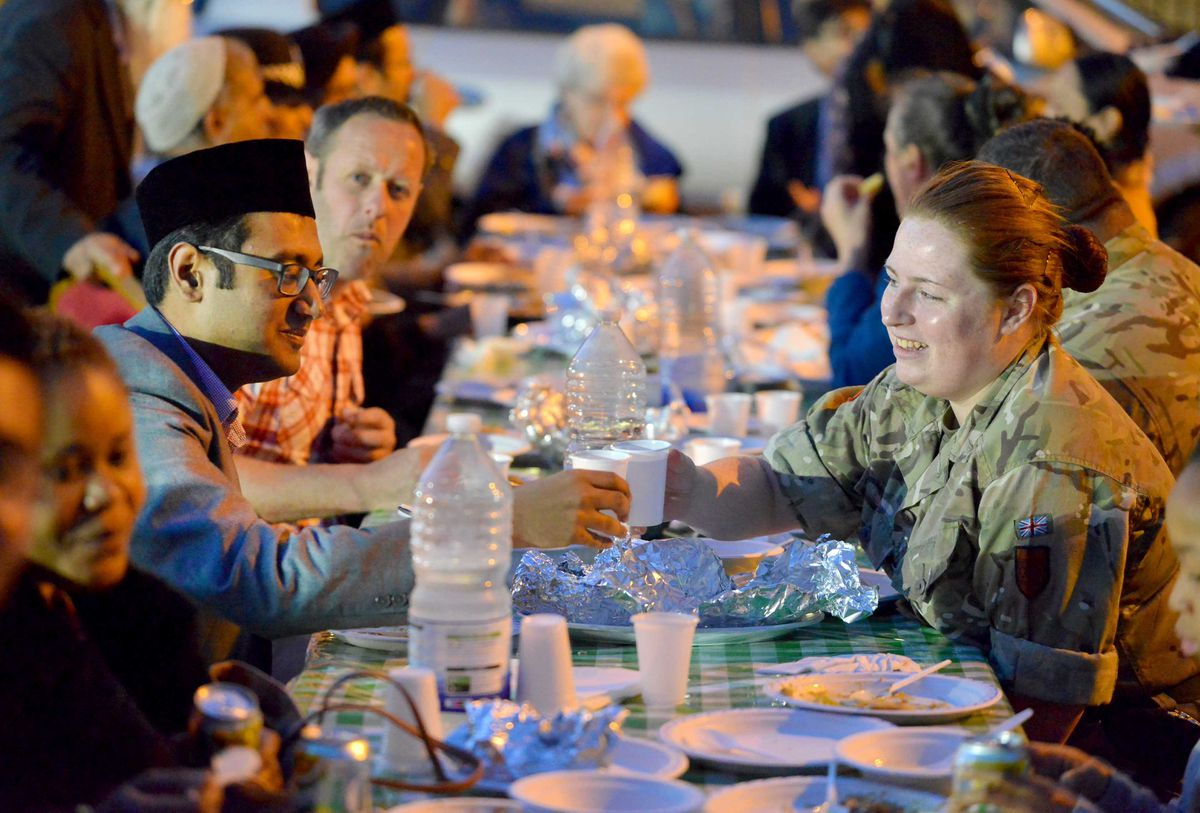 From the Mosque: Mazhar Warraich shares food with Kimberley Pyatt (Army Cadets, West Park)..