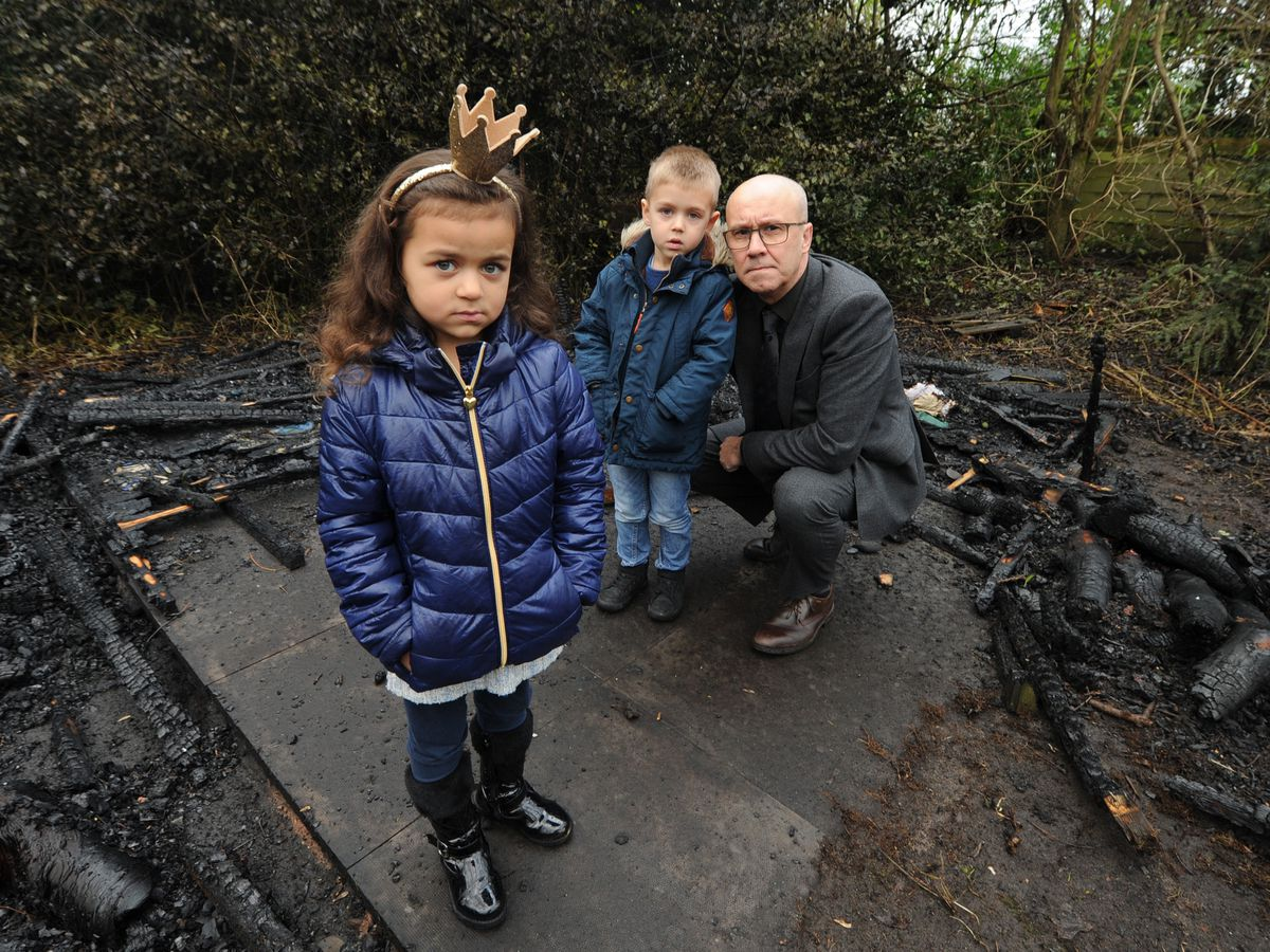 Merridale Primary School headteacher Simon Lane with pupils Essence Johnson and Daniel Dmitriev among the fire damage