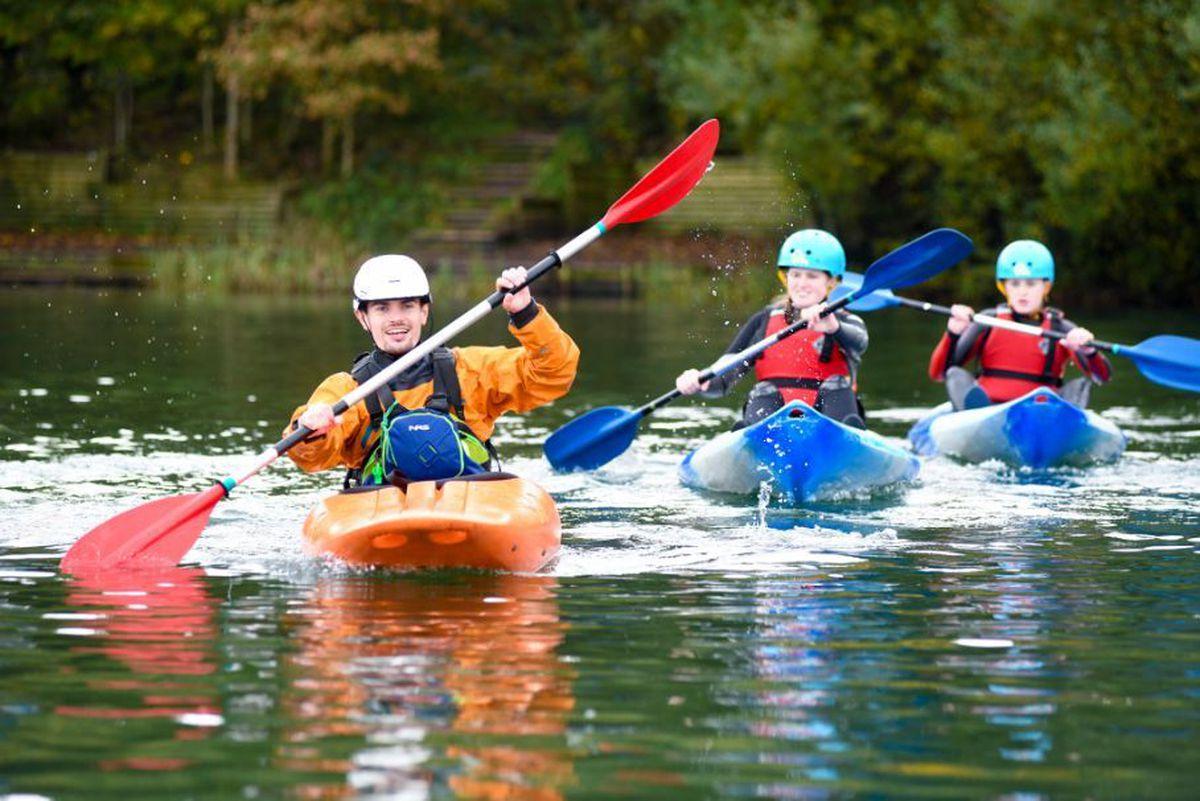 Children enjoying fun on the water at a Peak-organised activity