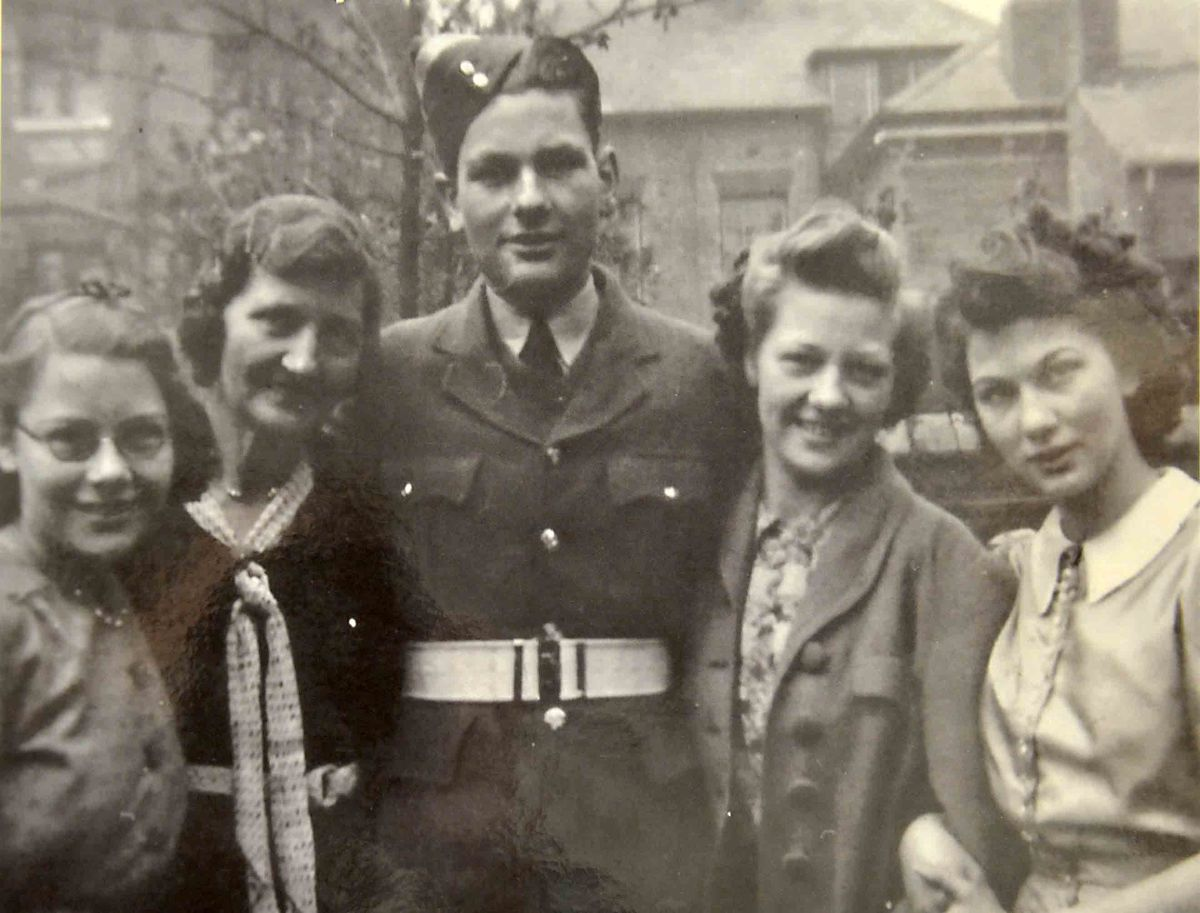 Ron Tomlin pictured in his RAF days with sister Jean, mother Florence, and sisters Carol and Gwen