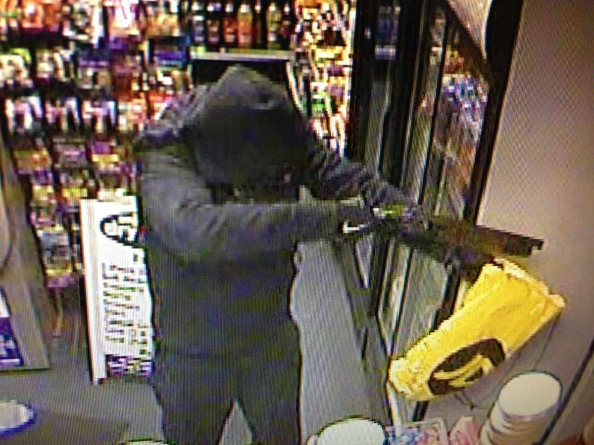 The gunman is caught on CCTV